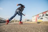 Cool Man Wearing Roller Skating Shoes