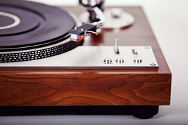 foto of analogy  - Stereo Turntable Vinyl Record Player Analog Retro Vintage Closeup - JPG