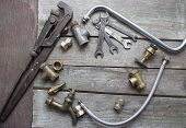 image of pipe wrench  - Old rusty plumber spanner set - JPG