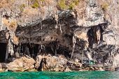 stock photo of phi phi  - A wooden pier at the Viking cave on the shore of Maya Island part of Phi Phi islands in Andaman Sea Thailand - JPG