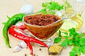 foto of fenugreek  - Tabasco adjika in a glass gravy boat - JPG