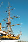 foto of sailing vessel  - Beautiful sailing vessel with big masts on the mooring - JPG