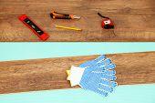 image of laminate  - Carpenter tools on new laminate floor - JPG