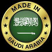 foto of saudi arabia  - Made in Saudi Arabia gold badge and icon with central glossy Saudi Arabian flag symbol and stars - JPG