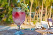 Постер, плакат: tropical shake refreshment drink in decorated glass on tropical background