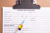 foto of medical chart  - Medical Chart and Syringe with yellow fluid - JPG