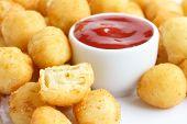 stock photo of dauphin  - Bowl of fried small potato balls on white - JPG
