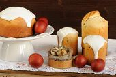 image of bird egg  - Kulichi traditional Russian easter cakes dyed eggs and bird nest on white cloth horizontal - JPG