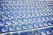 pic of tribunal  - Empty blue seats on sport arena tribune after the rain - JPG