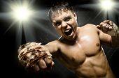 stock photo of cuff  - horizontal photo muscular young guy street - JPG