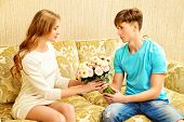 foto of sweetheart  - Young man giving flowers to his sweetheart - JPG
