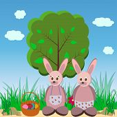 stock photo of duck egg blue  - Two of the Easter Bunny in the meadow with a basket of eggs - JPG