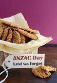 stock photo of biscuits  - Australian Anzac biscuits in vintage biscuit tin container with Lest We Forget message - JPG