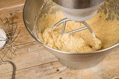 pic of food preparation tools equipment  - Food processor with beater tool preparing dough for a cake - JPG