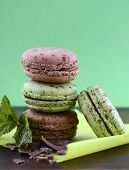 image of mint-green  - Chocolate and mint flavor macaroons on dark wood table and green background - JPG
