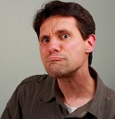 pic of frown  - White male staring at camera with an inquisitorial funny look - JPG