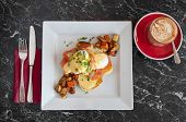 image of benediction  - A plate of delicious eggs benedict with salmon and saut - JPG