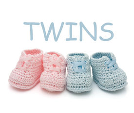 picture of twin baby  - Handmade pink and blue baby booties for twins isolated on a white background - JPG