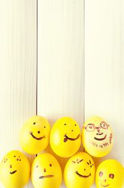 foto of human egg  - Funny eggs sitting in the tray - JPG