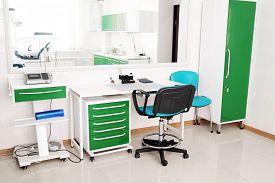 stock photo of overbite  - Desk doctor in dental clinic - JPG
