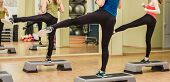 image of step aerobics  - Group of women making step aerobics in fitness club  - JPG
