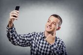 pic of selfie  - Happy young man taking a selfie photo - JPG