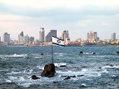 stock photo of perseus  - Flag of Israel on the Andromeda rocks on the background of Tel Aviv - JPG