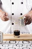image of condensation  - Chef putting condensed milk in to Hot coffee - JPG