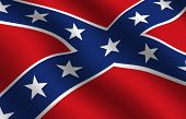 stock photo of redneck  - detail of waving confederate flag - JPG