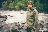 stock photo of survival  - Young Man bearded hiking outdoor with river and forest wild on background Lifestyle Travel survival concept - JPG