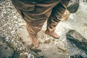 image of survival  - Feet Man trekking boots hiking outdoor Lifestyle Travel survival concept with river and stones on background top view - JPG
