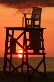 Empty Lifeguard Chair At Sunset