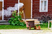 foto of boiling water  - Boiling water in large stove for outdoor laundry - JPG