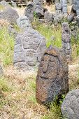 pic of stone sculpture  - Lava stone sculpture of an old man - JPG