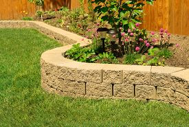 foto of grass  - stone wall with perfect grass landscaping in garden with artificial grass - JPG