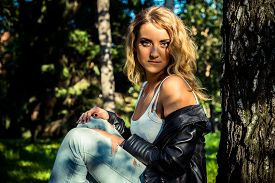 pic of jacket  - Hipster beautiful girl in leather jacket and jeans - JPG