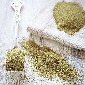 foto of green algae  - Kelp (algae) green powder , healtly superfood. ** Note: Shallow depth of field - JPG