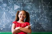 Portrait Happy Girl Resolving Complex Math Problem On Blackboard poster