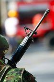 a photo of a soldier holding a machine gun