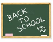 Back to school text on vector blackboard