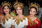 HUA HIN, THAILAND - NOVEMBER 21: Dancers in colorful costume. Thai people float on water a small raf