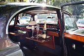 HUA HIN - DECEMBER 18: Champagne in the classic car. Retro Car on Vintage Car Parade 2010 at Sofitel