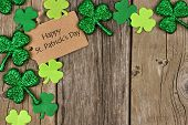 Happy St Patricks Day Tag With Corner Border Of Shiny Shamrocks Over A Rustic Wood Background poster