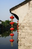 red lantern with old chinese house