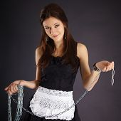 Young Beautiful Girl In Maid Costume With A Chain