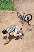stock photo of sports injury  - Unsuccessful performance of a trick has ended with falling of the bicyclist - JPG