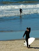 Surfer Adjusts Wetsuit