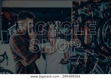 Bicycle Shop Salesman Showing Bicycle