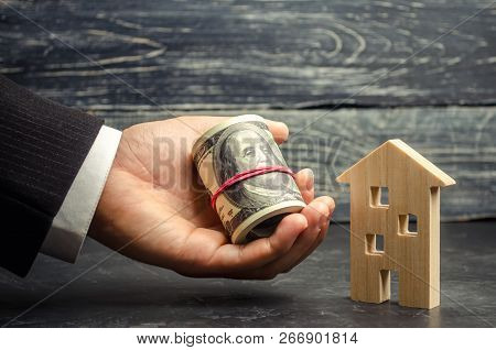 Wooden House And Money In