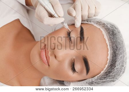 poster of Young Woman Undergoing Procedure Of Permanent Eye Makeup In Tattoo Salon